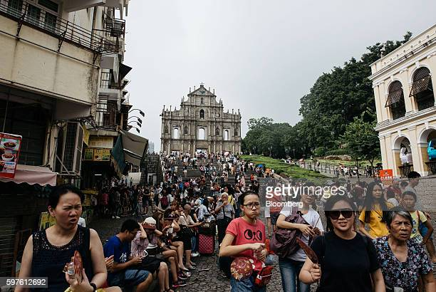 Tourists walk in front of the ruins of St Paul's Cathedral in Macau China on Sunday Aug 28 2016 Macau is scheduled to release gross domestic product...