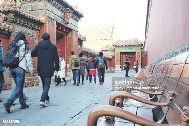 Tourists walk inside the Forbidden City in Beijing.