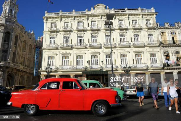 Tourists walk next to the Inglaterra Hotel in Havana on January 26 2017 Cuba is in style since there was an approach in its relationship with the...