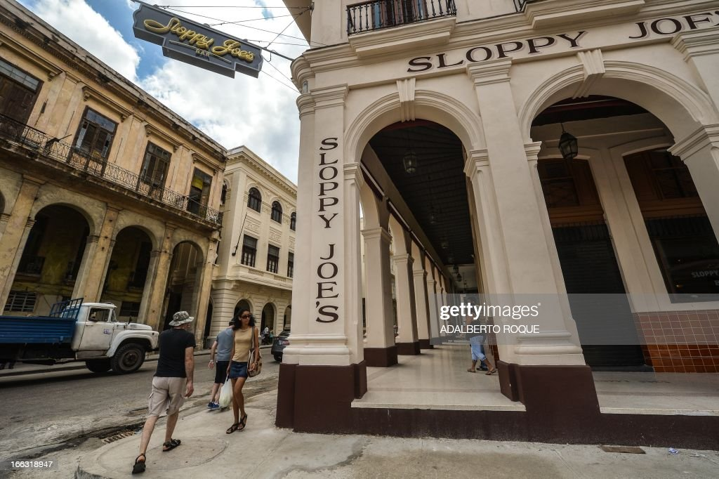 Tourists walk next to the newly renovated 'Sloppy Joe's' bar in Havana, on April 11, 2013. 'Sloppy' was one of the most famous places in the pre-revolutionary Cuba. The bar was inaugurated in 1920 and closed its doors in the 70's. US celebrites like actors as John Wayne, Errol Flynn and Clark Gable used to visit the place during its golden years.