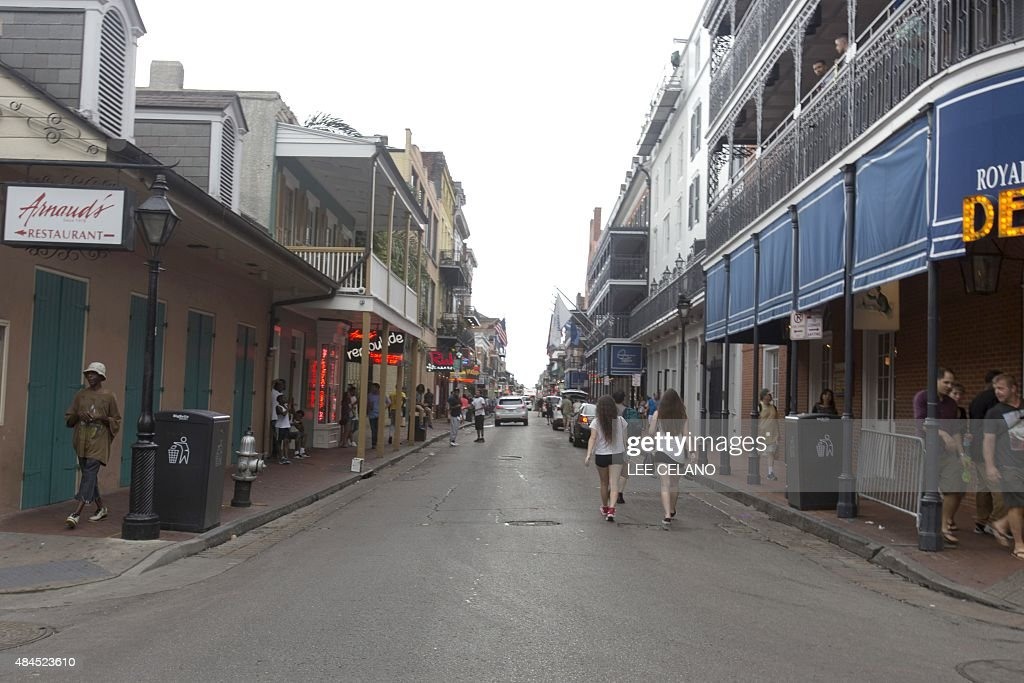 Tourists walk on Bourbon Street in New Orleans on August 16 2015 Ten years ago Hurricane Katrina swept buildings off their foundations and deluged...