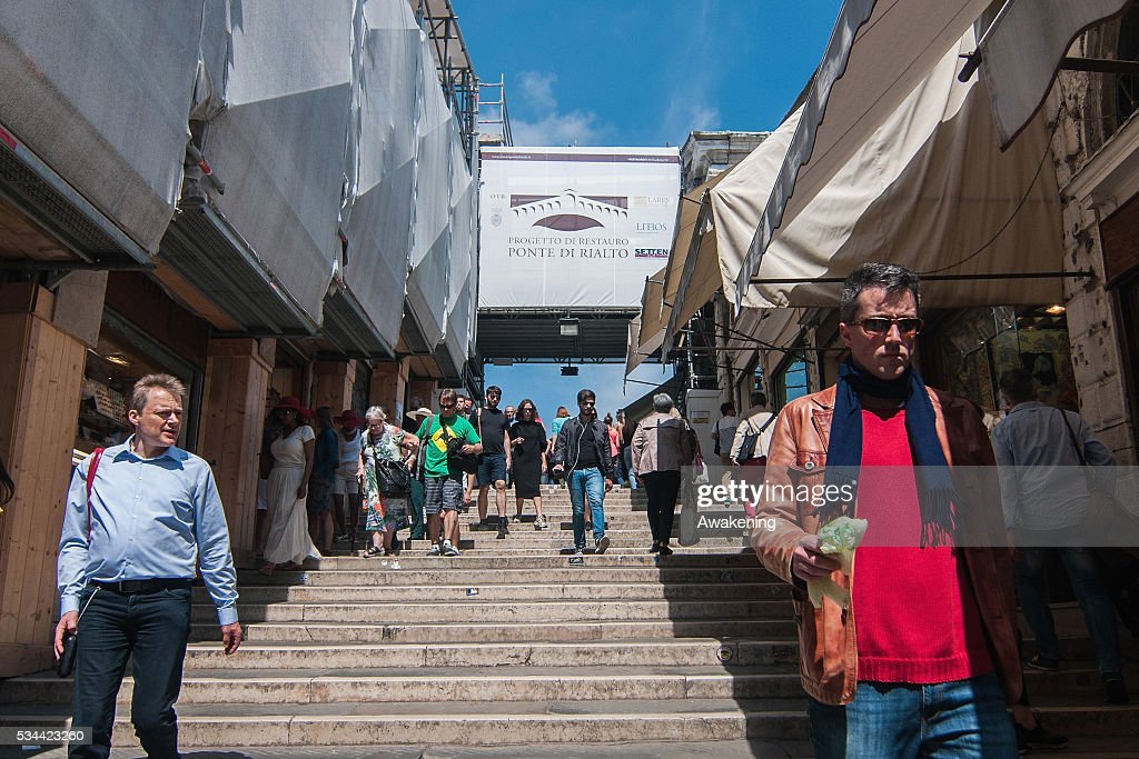 Tourists walk on the central stairs during the renovation of the Rialto Bridge on May 26, 2016 in Venice, Italy. Site visits were organized to see the renovation of the Rialto bridge to coincide with the 15th Biennale of Architecture in Venice.