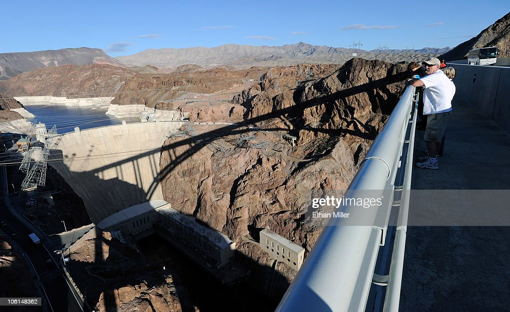 Tourists walk on the pedestrian walkway on the Mike O'Callaghan-Pat Tillman Memorial Bridge part of the Hoover Dam Bypass Project October 26, 2010 in the Lake Mead National Recreation Area, Nevada. The 1,900-foot-long structure sits 890 feet above the Colorado River, about a quarter of a mile downstream from the Hoover Dam. The USD 240 million four-lane bypass project to relieve vehicle traffic on the Hoover Dam began in 2003, and opened to traffic on October 19.