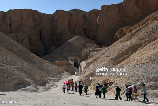 Tourists walk outside King Tutankhamun's tomb at the Valley of the Kings near Egypt's southern city of Luxor on March 31 2016 Further analysis is...