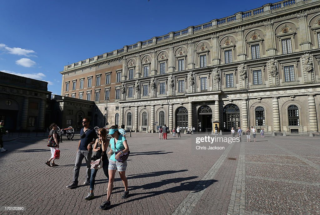 Tourists walk outside the Royal Palace as preparations for the wedding of Princess Madeleine of Sweden and Christopher O'Neill continues on June 7, 2013 in Stockholm, Sweden.