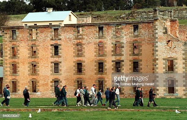 Tourists walk past the remains of the gaol at the Port Arthur historic site Tasmania 23 April 1998 SMH Picture by BRUCE MILLER