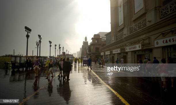 Tourists walk the boardwalk near casinos in Atlantic City New Jersey August 17 2010 The 11 Atlantic City casinos reported a 226 percent decline in...