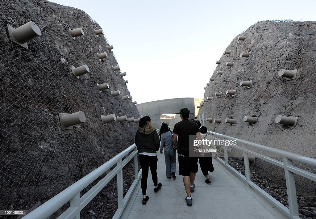 Tourists walk through a pedestrian plaza featuring protruding rock anchors at the Mike O'Callaghan-Pat Tillman Memorial Bridge part of the Hoover Dam Bypass Project October 26, 2010 in the Lake Mead National Recreation Area, Nevada. The 1,900-foot-long structure sits 890 feet above the Colorado River, about a quarter of a mile downstream from the Hoover Dam. The USD 240 million four-lane bypass project to relieve vehicle traffic on the Hoover Dam began in 2003, and opened to traffic on October 19.