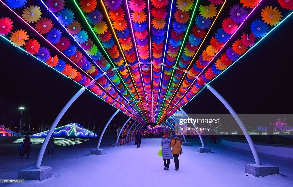 Tourists walk through an illuminated and decorated road during the 33rd Harbin International Ice and Snow Festival at Harbin Ice And Snow World in Harbin, China on January 16, 2017. The Festival, established in 1985, is held annually on January 5 and lasts over a month.