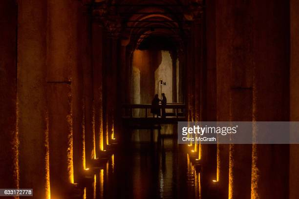 Tourists walk through the famous Basilica Cistern on January 31 2017 in Istanbul Turkey According to a Turkish Statistics Institute report released...