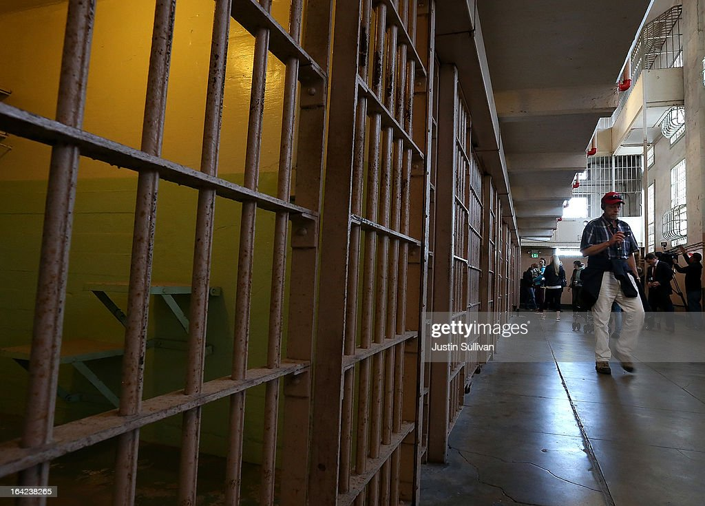 Tourists walk through the main cell block at Alcatraz Island on March 21 2013 in San Francisco California The National Park Service marked the 50th...