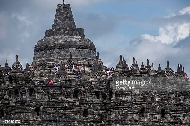 Tourists walk through the network of platforms at the Borobudur temple The temple built in the 8th century is one of the largest Buddhist monuments...