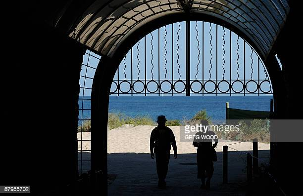 Tourists walk through the recently restored 'Whalers Tunnel' under the 'Round House' the oldest remaining building in Western Australian and still on...