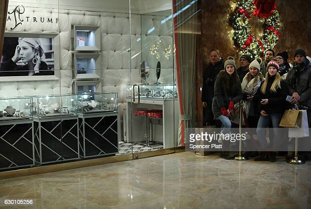 Tourists walk through Trump Tower on December 16 2016 in New York City Since PresidentElect Donald Trump's win thousands of Trump fans tourists and...