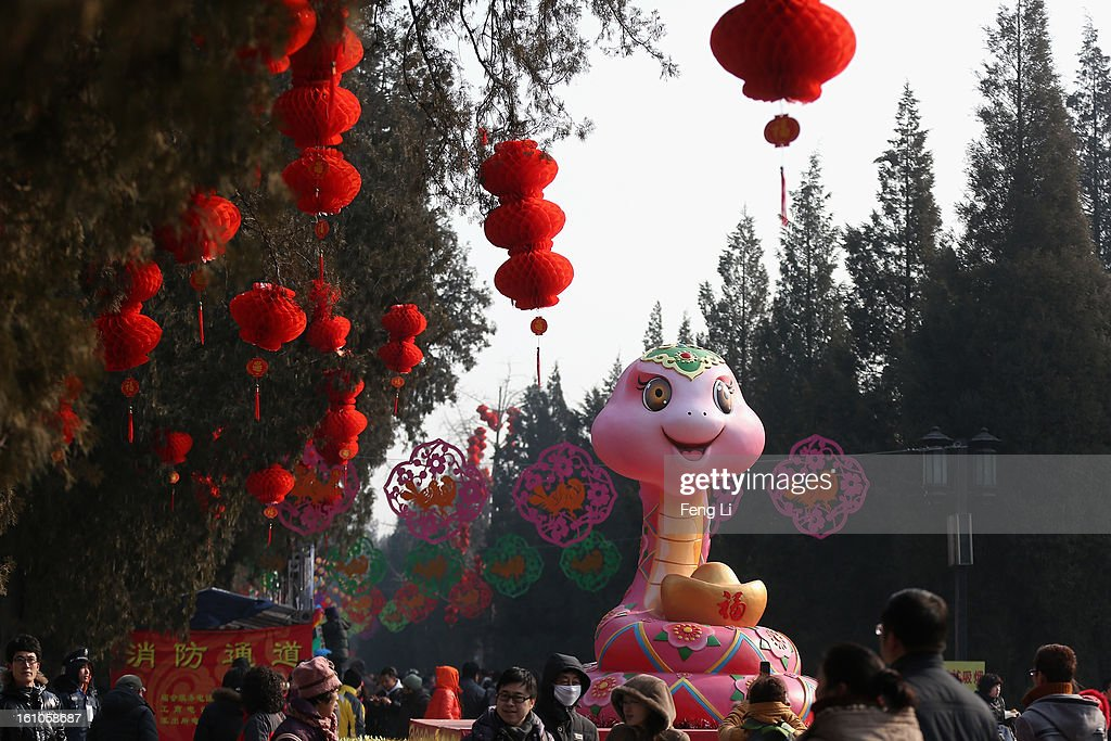 Tourists walk under a snake sculpture at the Spring Festival Temple Fair for celebrating Chinese Lunar New Year of Snake at the Temple of Earth park on February 9, 2013 in Beijing, China. The Chinese Lunar New Year of Snake also known as the Spring Festival, which is based on the Lunisolar Chinese calendar, is celebrated from the first day of the first month of the lunar year and ends with Lantern Festival on the Fifteenth day.
