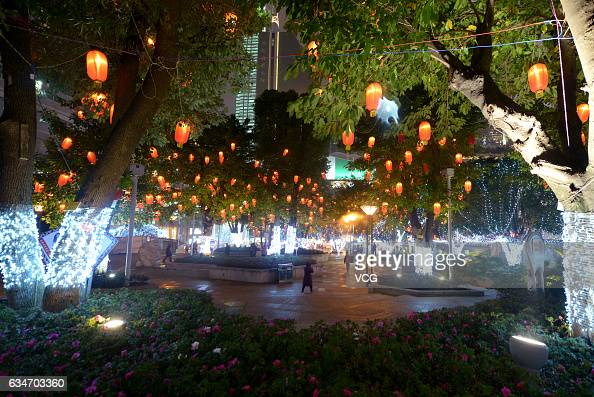 Tourists walk under lanterns of a multitude of colors at Jiefangbei Pedestrian Street on February 10 2017 in Chongqing China Tourists appreciate...