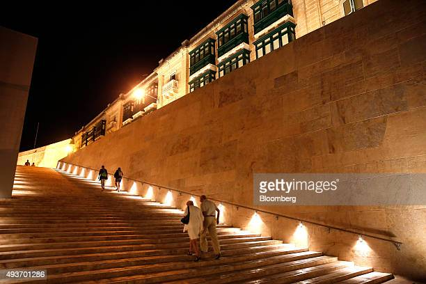 Tourists walk up the illuminated stairs of the city's main gate in Valletta Malta on Tuesday Oct 20 2015 ECB President Mario Draghi will convene his...