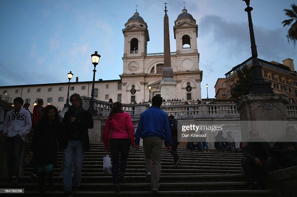 Tourists walk up the Spanish Steps on March 27, 2013 in Rome, Italy.