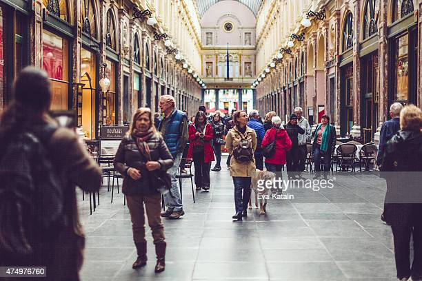 Tourists walking down the Galeries Royales Saint-Hubert