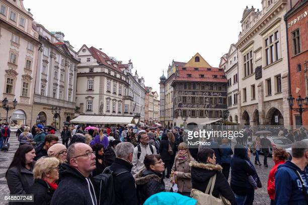 Tourists walking in Old Town Square of Prague the capital city of Czech Republic during the winter on a cloudy day Most of the shots are in the...