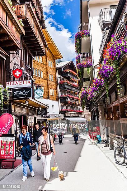 Tourists walking in Zermatt village, Switzerland