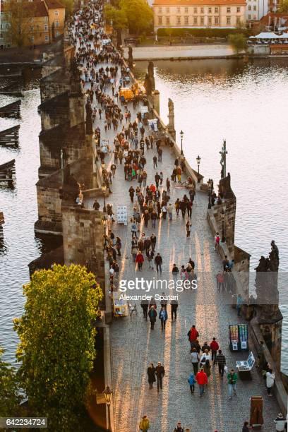 Tourists walking on Charlse Bridge in Prague, Czech Republic