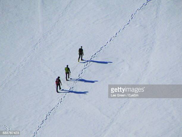 Tourists Walking On Snow In Winter