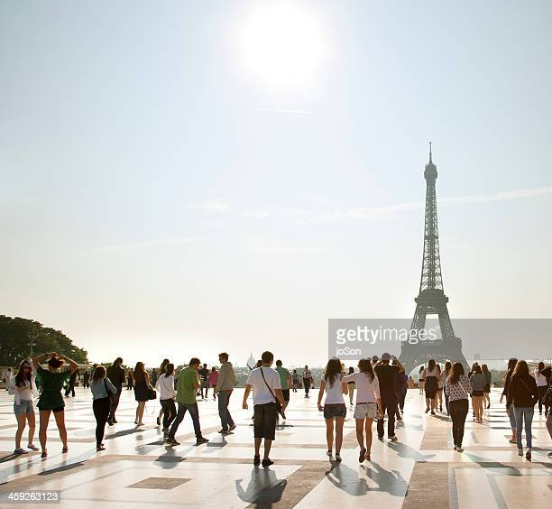 Tourists walking to the Eiffel Tower, morning