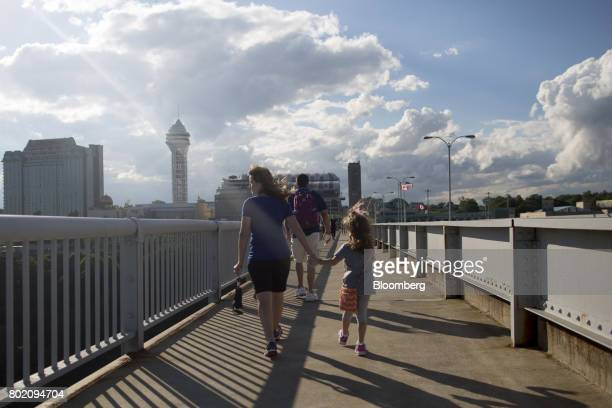 Tourists walks across the Niagara Falls International Rainbow Bridge in Niagara Falls Ontario Canada on Wednesday June 21 2017 The 150th anniversary...