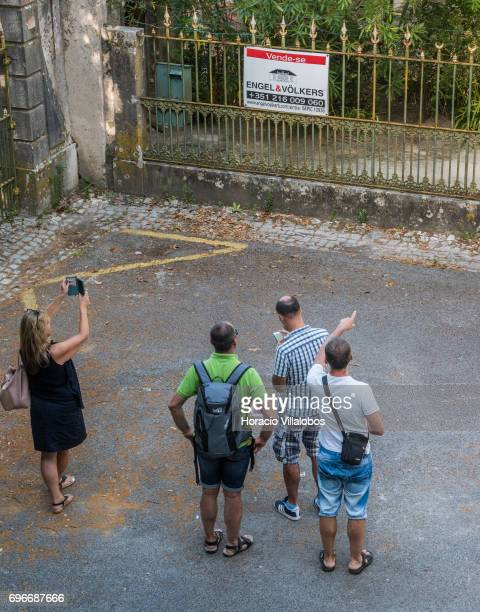 Tourists watch the Quinta do Relogio that according to the local news site SintraNoticias has been bought by Pop singer Madonna for 75 million euros...