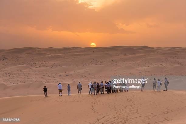 Tourists watching the desert sunset