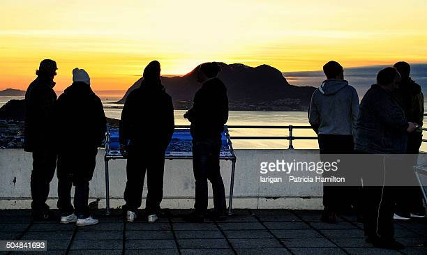 Tourists watching the sunset in Norway