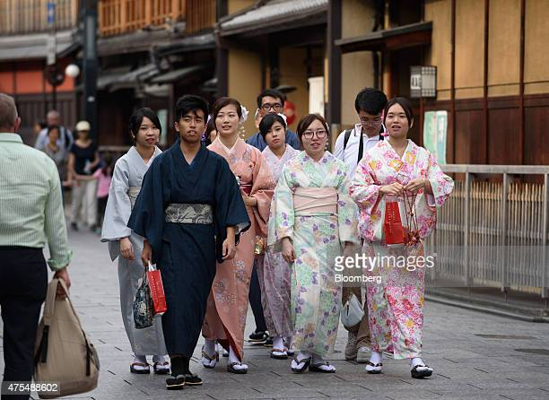 Tourists wearing rental kimonos walk through the Gion area of Kyoto Japan on Thursday May 28 2015 Spending by visitors to Japan jumped to the highest...