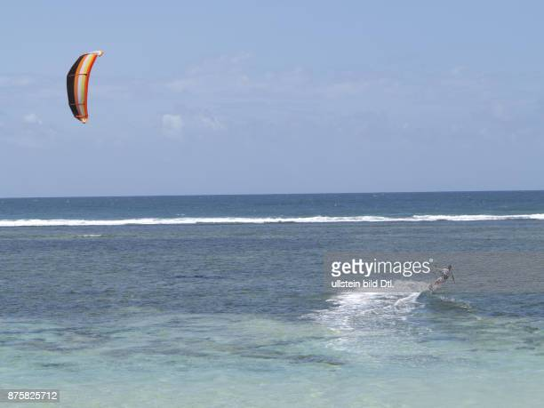 Tourists wind surfing on the beach at Tiwi on Indian Ocean coast Kenya