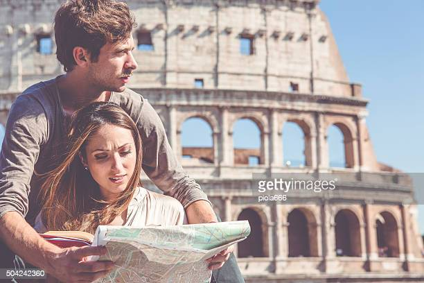 Tourists with  map in front of the Coliseum