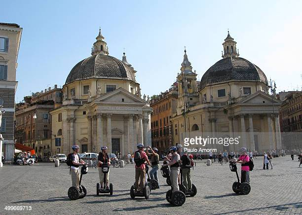 CONTENT] Tourists with segway tur at the twin churches Sant Maria in Montesanto and Santa Maria dei Miracoli 161191 at Piazza del Popolo in RomeItaly