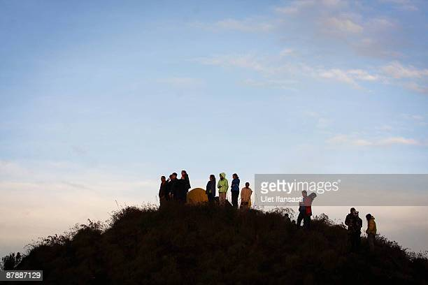Tourists witness Mount Rinjani also known as Gunung Rinjani on May 19 2009 in Lombok West Nusa Tenggara Province Indonesia The 3726m active volcano...