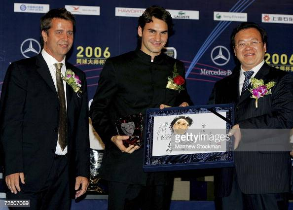 Tournament Director Brad Drewett Roger Federer of Switzerland and Chen Jing dierector of Minhang district pose for photographers at the opening...