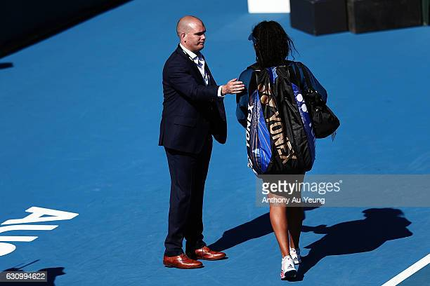 Tournament Director Karl Budge walks Naomi Osaka of Japan off the court after she pulled out of her quarter final match against Ana Konjuh of Croatia...
