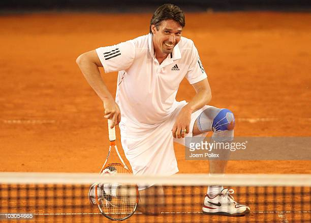 Tournament director Michael Stich of Germany looks on during his friendly match against Yannick Noah of France during the International German Open...