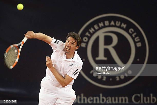 Tournament director Michael Stich of Germany returns a forehand during his friendly match against Yannick Noah of France during the International...