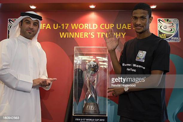 Tournament Director Mohammed bin Bdoua and UAE football player Sultan Al Shamsi pose with the FIFA U17 World Cup Trophy on September 18 2013 in Abu...