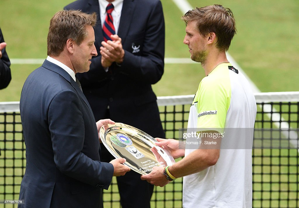 Tournament director Ralf Weber congratulates Andreas Seppi of Italy plays after losing the final match against Roger Federer of Switzerland during...