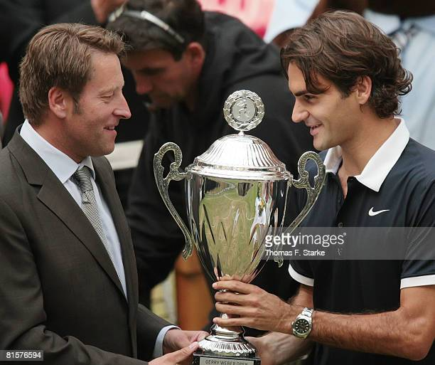 Tournament director Ralf Weber congratulates Roger Federer of Switzerland after the final match of the Gerry Weber Open on June 15 2008 at the Gerry...
