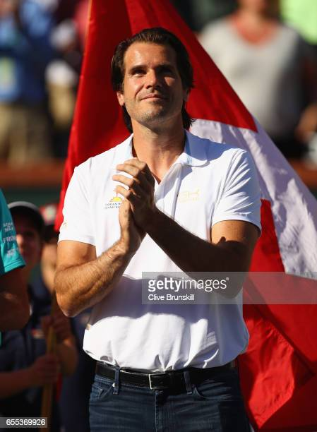 Tournament director Tommy Haas listens to Roger Federer of Switzerland make his winners speach after his straight sets victory against Stanislas...