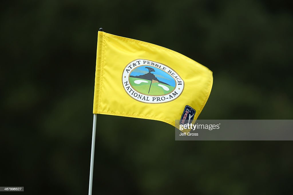 A tournament flag billows in the wind during the third round of the AT&T Pebble Beach National Pro-Am at the Spyglass Hill Golf Course on February 8, 2014 in Pebble Beach, California.