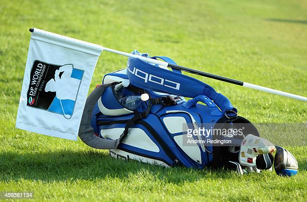 A tournament flag rests on a golf bag during the second round of the DP World Tour Championship at Jumeirah Golf Estates on November 21 2014 in Dubai...