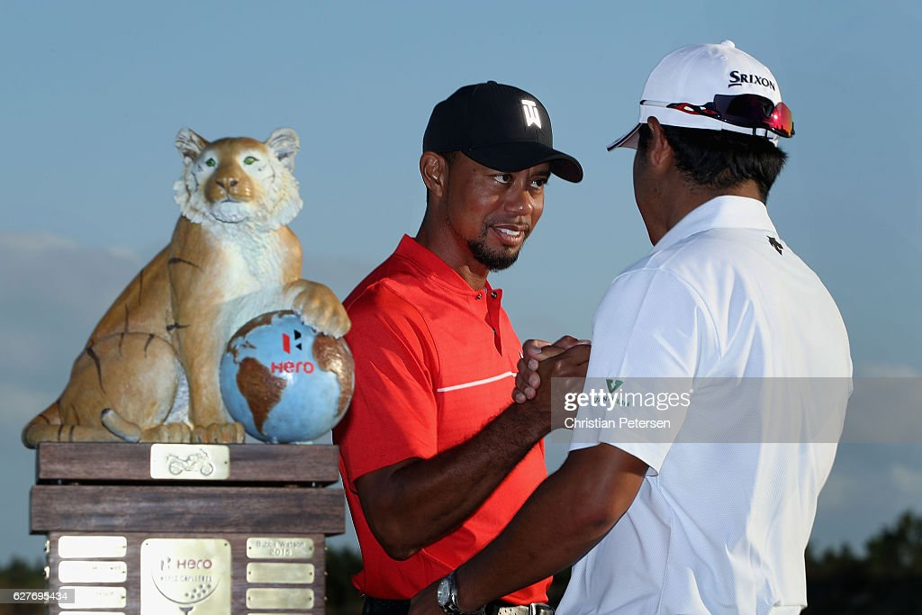 Tournament host and player Tiger Woods (C) shakes hands with Hideki Matsuyama of Japan after Matsuyama won the Hero World Challenge at Albany, The Bahamas on December 4, 2016 in Nassau, Bahamas.