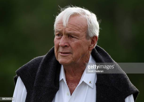 Tournament host Arnold Palmer walks across the practice ground during the final round of the Arnold Palmer Invitational presented by MasterCard at...