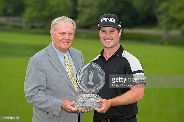 Tournament host Jack Nicklaus and David Lingmerth of Sweden pose with the tournament trophy after Lingmerth wins the Memorial Tournament presented by...
